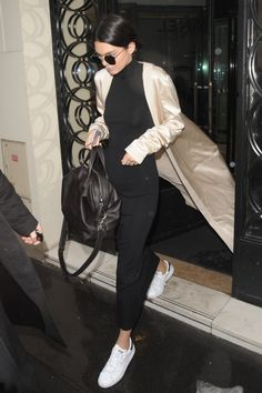 Kendall Jenner wearing  August Getty Atelier SS16 Duster Coat, Sally Lapointe Knit High Neck Dress, Givenchy Small Nightingale Bag, Lola James Jewelry Mini Me Friendship Kengi Necklace, Lola James Jewelry Mini Me Friendship Cake Necklace, Ahlem Eyewear Concorde Sunglasses in Palladium White Gold, Adidas Stan Smith Sneaker