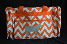 """Duffle bags are available in Zebra, Demask, Camo, Chevron, Polka Dot, and Aztec Prints. We can put a steer, heifer, lamb, goat, chicken, horse, pig, or FFA on the suitcases and in the following colors: Pink Glitter, Green Glitter, Royal Blue Glitter, Turquoise Glitter, Aqua Glitter, Purple Glitter, Gold Glitter, Silver Glitter, Iridescent Glitter, Black Glitter, and Orange Felt. To clean, wipe with a damp cloth. Duffle bag dimensions are approximitely: 10""""(h), 18""""(w), 12""""(d)"""