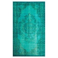 Turquoise rug with a distressed Persian motif. Made in Turkey.     Product: Rug    Construction Material: 100% Polyamide    Color: Turquoise      Features: Made in Turkey  Note: Please be aware that actual colors may vary from those shown on your screen. Accent rugs may also not show the entire pattern that the corresponding area rugs have.          Cleaning and Care: Spot clean
