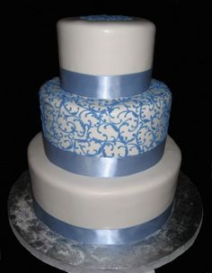 silver wedding cake - love the colour of the ribbon