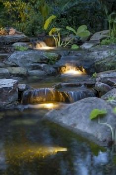 Garden Design Cascading backyard waterfall lit up at night! - With today's busy lifestyle, it can be difficult to enjoy your pond during the day. Underwater lights create a whole new experience by your pond after the sun goes down. Waterfall Lights, Garden Waterfall, Waterfall Design, Pond Lights, Diy Waterfall, Waterfall Fountain, Backyard Water Feature, Ponds Backyard, Backyard Waterfalls