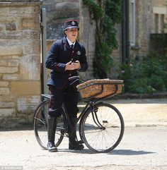 Downton Abbey --> On your bike: One of the extras on the show rose a gorgeous bike complete with a basket, and must have been feeling the heat in his heavy costume