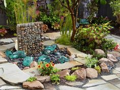 "This patio water fountain features ""rocks"" recycled from windshield glass."