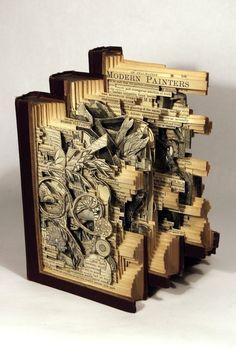 boeken chirugie..Boekenchirurg Brian Dettmer bewerkt de boeken pagina voor pagina en zal nooit een stuk toevoegen of verplaatsen aan het kunstwerk. Door zijn precieze knutselwerk ontstaan er hele toffe kunstwerken!