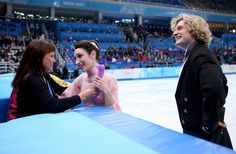 Meryl Davis and Charlie White of the United States si welcomed by their coach Marina Zoueva after competing during the Figure Skating Ice Da...