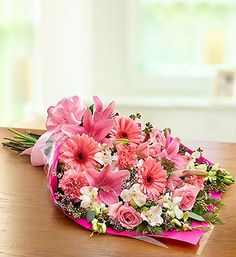 Make them feel like a star with a stunning surprise: the freshest roses, alstroemeria, carnations, Gerberas, lilies and more, hand-arranged by our expert florists into a stunning presentation bouquet they can carry gracefully over their arm. Finished off with a stylish ribbon, it's perfect for graduations, dance recitals, awards ceremonies, proms or any occasion that puts them in the spotlight.