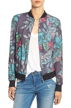 Bold illustrations of blossoming flowers color this lightweight bomber jacket with a varsity collar and rib-knit trim.