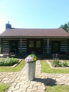 Our little log cabin in front of the herb garden. .tom and debbie...2013