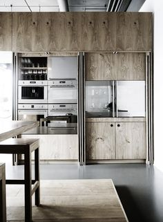 Plywood kitchen cabinets with folding doors on side to hide counters.