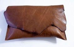 Leather raw edge clutch.