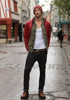 Try teaming a red puffer jacket with black jeans for a dapper casual get-up. Round off this look with dark brown leather casual boots.   Shop this look on Lookastic: https://lookastic.com/men/looks/puffer-jacket-shawl-cardigan-v-neck-t-shirt/21115   — Red Beanie  — Olive Shawl Cardigan  — Red Puffer Jacket  — White V-neck T-shirt  — Dark Brown Leather Belt  — Black Jeans  — Dark Brown Leather Casual Boots