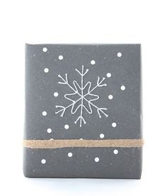 DIY Gift Wrap Idea #8: Baker's Twine Snowflake This awesome tutorial shows you how to shape an elaborate snowflake design with pins and baker's twine. Sprinkle the package with a few cutout dots and you're set with one beautiful bundle.