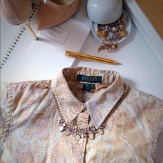 Gorgeous paisley Oxford shirt So gorgeous!!!! Looking for that perfect print to inspire you? This paisley is so feminine and artistic! The shirt has buttons with RL Lauren in pretty opaque. Size runs true. This is a small petite. Ralph Lauren Tops