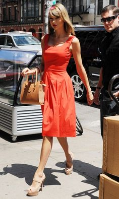Talk about a lady (in red). We love Taylor's penchant for classic silhouettes, and this one's just about as flattering as it gets.