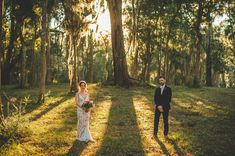 Bohemian wedding in Jacksonville, Florida. We love the bride's tan and white lace wedding dress! | GG Events
