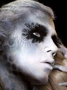 Art of Darkness makeup from the make up experts at Illamasqua - Fully feathered eyes on reptile skin.