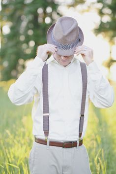 Suspenders and #fedora. Photography by parkroadphotography.com Read more - http://www.stylemepretty.com/2013/09/26/herb-infused-inspiration-from-alisa-lewis-event-design-and-park-road-photography/