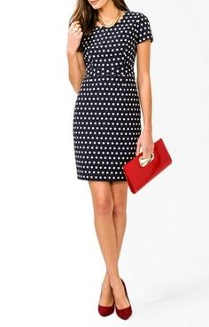 navy and white polka dot structured dress / red clutch / gold necklace / red pumps / ring