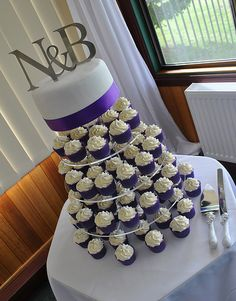 Purple and White Wedding Cupcake Tower - a photo on Flickriver