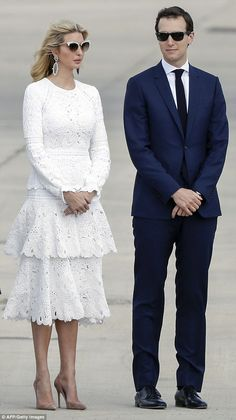 The couple kept their hands clasped in front of them as they waited on the runway