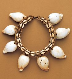 Eastern Indonesia | A Tanimbar man's necklace | Shells and rattan | Early 20th century | The Tanimbar Archipelago is one of the most important sources of Indonesian 'primitive' art. This necklace belongs to a chieftain decorated with ovula-ovum shells, which have been a medium of exchange in Indonesia since time immemorial.