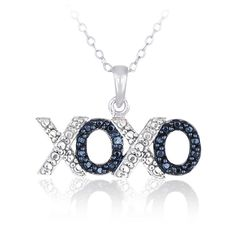 This dainty pendant features a sterling silver pave 'XOXO' design symbolizing love, hugs and kisses. There is one genuine blue diamond amongst a pave design giving an illusion of additional stones.