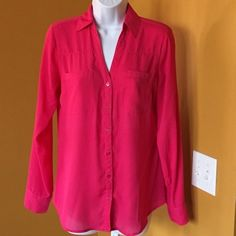 HOT PINK EXPRESS PORTOFINO SHIRT POP!!! V-neck double pocket on bust line. You are able to roll up the sleeves and button them in place. Day to Night with this top. -No trades. Express Tops Blouses