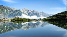 """The hike to Happo pond from Hakuba -- a village known for its winter skiing amid the mountains of Nagano Prefecture -- is a classic trail in the Japanese Alps. <br />Surrounded by the Hakuba Peaks, the pond is 2,060 meters above sea level. <br />What the pond lacks in size, it makes up for in beauty, reflecting the 3,000 meter tall peaks in its quiet waters.<em><br /><a href=""""http://www.hakuba-happo.or.jp/"""" target=""""_blank"""">Hakuba Happo-one Na..."""