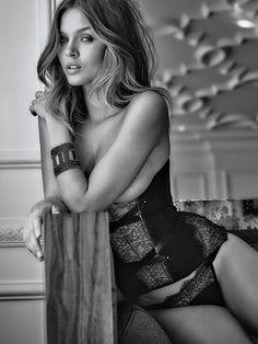 Always daring, never demure: this cupless corset makes sexy seem like an understatement.   Victoria's Secret Ribbon Corset