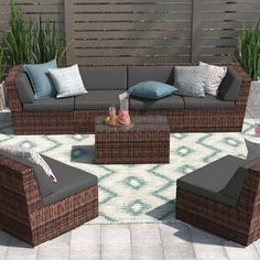 Sol 72 Outdoor™ Merlyn 11 Piece Sectional Seating Group with Cushions | Wayfair Brown Cushions, Natural Cushions, Pool Floats For Adults, Turquoise Cushions, Outdoor Seating Areas, Outdoor Furniture Sets, Outdoor Decor, Modular Design, Swinging Chair