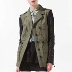 Zara safari jacket Excellent condition. Still has the spare button attached on the inside. Size medium in women's. No longer sold in stores. Retailed at about $120 I believe. Olive/khaki color with genuine leather (lamb skin) sleeves and detail. Zara Jackets & Coats Utility Jackets