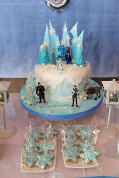 Fantastic cake and cookies at a Frozen birthday party! See more party planning ideas at CatchMyParty.com!