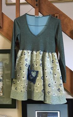 This dress/tunic has the softest top you can imagine, the bottom part has a fullness and feminine look. Has a jean pocket with hearts for a bit of funkiness. Can be casual or for a party as well. Size is a small/medium Bust 15 1/2 lying flat with a bit of stretch Length 31