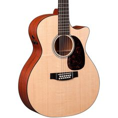 Martin GPC12PA4. Grand performance with cutaway body sizeSolid Sitka spruce topHybrid ''X'' scallopedHigh performance neckFishman F1 Analog pickup systemIncludes 375 Hardshell case.