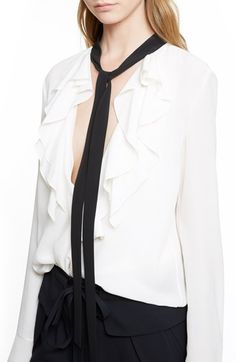 Chloe white ruffle blouse with black tie $1,250 @ Nordstrom