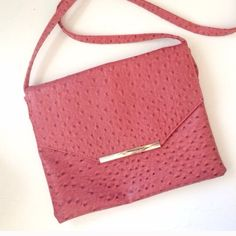 Only $18 Convertible CrossBody/Clutch Pre-loved but great condition. Faux ostrich leather. Use it as a clutch or crossbody bag. Strap is removable.10 Bags Clutches & Wristlets