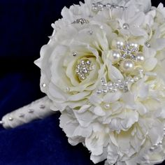 This is only to show you what the bouquet jewelry is. I have this same pearl and diamond look to go in mine.