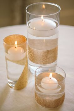 Simple and elegant gold centerpieces with floating candles #wedding #candle #centerpiece #gold #diywedding