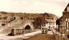 1953, Pontypridd Old Bridge and adjacent new bridge. The footbridge was designed and built by William Edwards, Stonemason, Engineer, Bridge Builder. This was the longest span in world when completed in 1756.