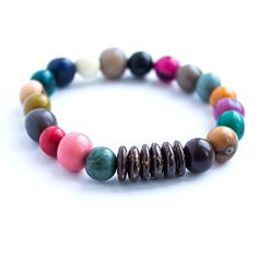 Esperanza Bracelet | $9 | Dyed acai berries joined with round coconut beads. Handcrafted in Ecuador by young women overcoming exploitation. More color options available. #ecofriendly #acaibracelet #fairtrade