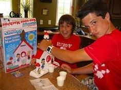 his face! i'm dying lol This Is so much funnier because my sister has a snoopy snow cone maker!