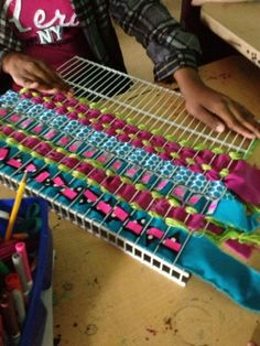 "They're weaving on a old wire closet shelf!!! (""There's a Party in the Art Room!: Woven Wall Hangings with Reusable Materials"")"