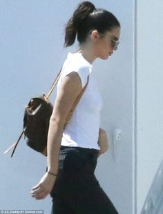 Easy hairstyle: The Keeping Up With the Kardashians kept her dark locks up in a high ponytail