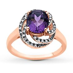 A shimmering oval amethyst rests upon swirls of icy round white diamonds totaling 1/10 carat in this stunning ring for her. The fashion ring is crafted in 10K rose gold. Diamond Total Carat Weight may range from .085 - .11 carats.  Gently clean by rinsing in warm water and drying with a soft cloth.