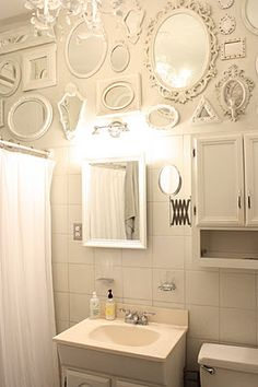 Mirrors, mirrors, and more mirrors. love this..and the fact that they are the color of the wall..or very close!!
