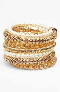 Free shipping and returns on Spring Street Coil Bracelet at Nordstrom.com. Amp up your accessory collection with this polished coil bracelet crafted with a bevy of textures and luminous beads that creates a stacked look in one easy piece.