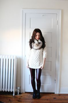 Sydney wearing burgundy liquid leggings, cable knit sweater from Zara and faux fur snood (from The Day Book)
