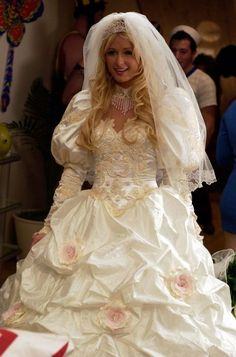 Paris Hilton Hilton's Cristabel Abbott donned this elaborate wedding gown in the 2008 comedy The Hottie and the Nottie. Ugly Wedding Dress, Worst Wedding Dress, Movie Wedding Dresses, Celebrity Wedding Dresses, Wedding Movies, Stunning Wedding Dresses, Designer Wedding Dresses, Celebrity Weddings, Bridal Dresses