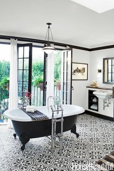 Stunning tile in this black and white bathroom