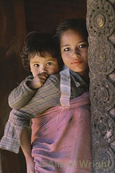 Sisters. Bhaktapur, Nepal by Alison Wright